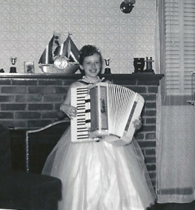 Image:  Joanne Boling holding accordion