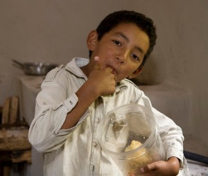 Honduran Bee Project to Initiate Honey Production and Commercialization, #23-0057-02; Aldea la Crucita community, Siguatepeque municipality, Comoyaqua state; Santiago Morales-Mata,53, and Isabel Ramos, 50 recipients since 2002; Pictured is: Rafael Morales; 10; especially likes all that honey!